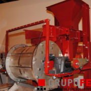 Rotray drum (permanent) under a vibrating feeder and a hopper